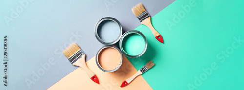 Metal paint cans and paint brushes on multicolor background Fototapeta