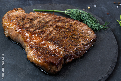 Canvastavla Grilled beef steak ribeye rare on on dark background
