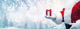 Fototapeta Kawa jest smaczna - Christmas present from Santa Claus. Winter Holiday Background