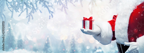 Photo  Christmas present from Santa Claus. Winter Holiday Background