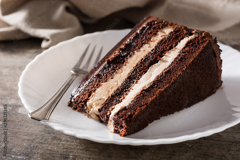 Fototapety, obrazy: Chocolate cake slice on wooden table