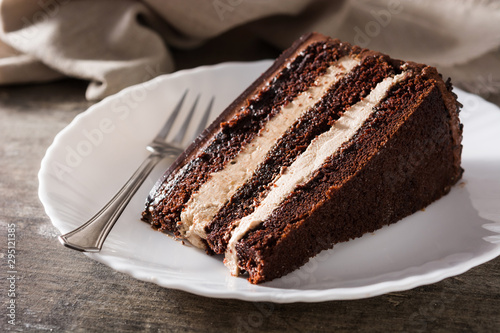 Fényképezés Chocolate cake slice on wooden table