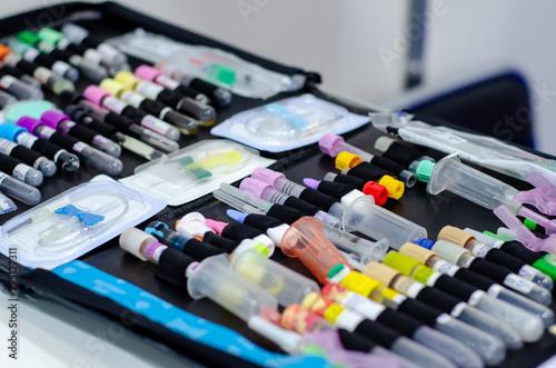 Fotografia  Close-up of new medical test tube and .syringe.