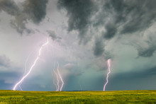 Multiple Bolts Of Lightning Strike The Ground During A Lightning Storm.
