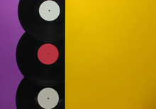 Halves Of Vinyl Records On A Purple Yellow Background. Retro Music Albums, 70s. Top View