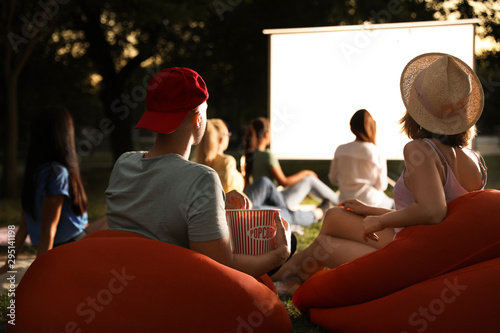 Young couple with popcorn watching movie in open air cinema Canvas-taulu