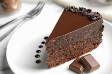 Delicious Fresh Chocolate Cake Served On White Table, Closeup