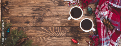 Photo sur Toile Cafe Christmas coffee cups with Fir Tree Branches, toys, plaid on Wooden Background, banner