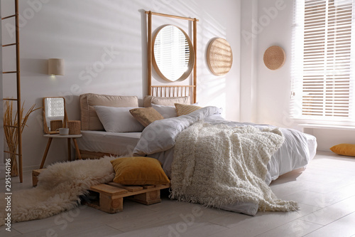 Stylish modern room interior with  comfortable bed Canvas Print