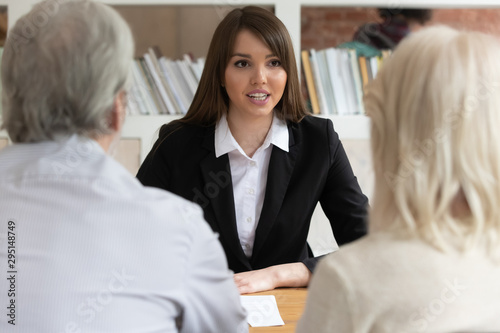 Valokuvatapetti Female bank specialist speak consulting mature clients