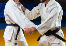 Martial Arts. Sparing Portners. Sport Man And Woman In White Kimono Train Judo Captures In The Sports Hall. Crop Photo