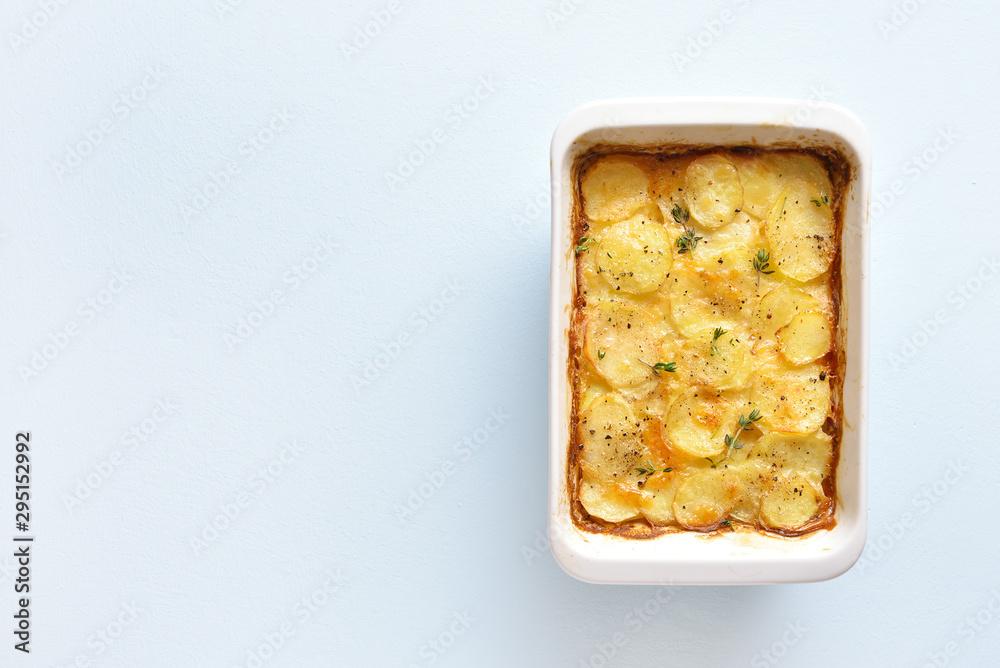 Fototapety, obrazy: Potato gratin in baking dish