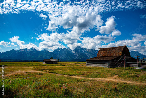 Fototapeta Mormon home and barn by the mountain
