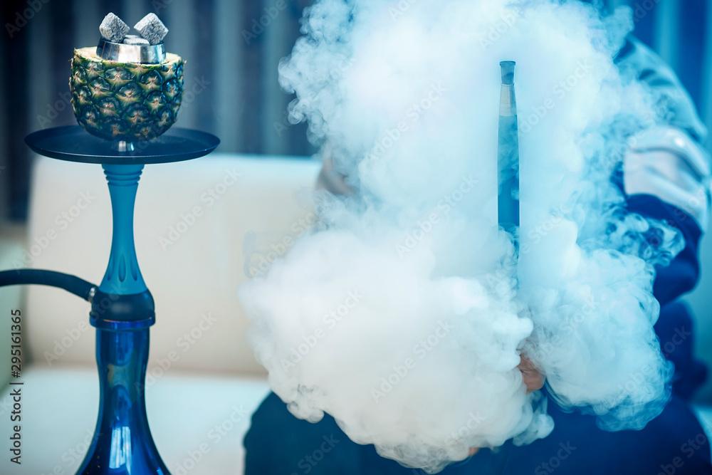 Fototapety, obrazy: Man holds hookah, hand in smoke shisha