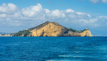 Miseno Cape With Lighthouse As Seen From The Ferry To Procida. Naples, Campania, Italy.