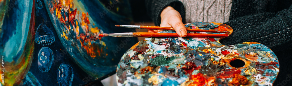Fototapety, obrazy: Modern fine art school. Female painter holding colorful palette and paintbrushes over abstract artwork.