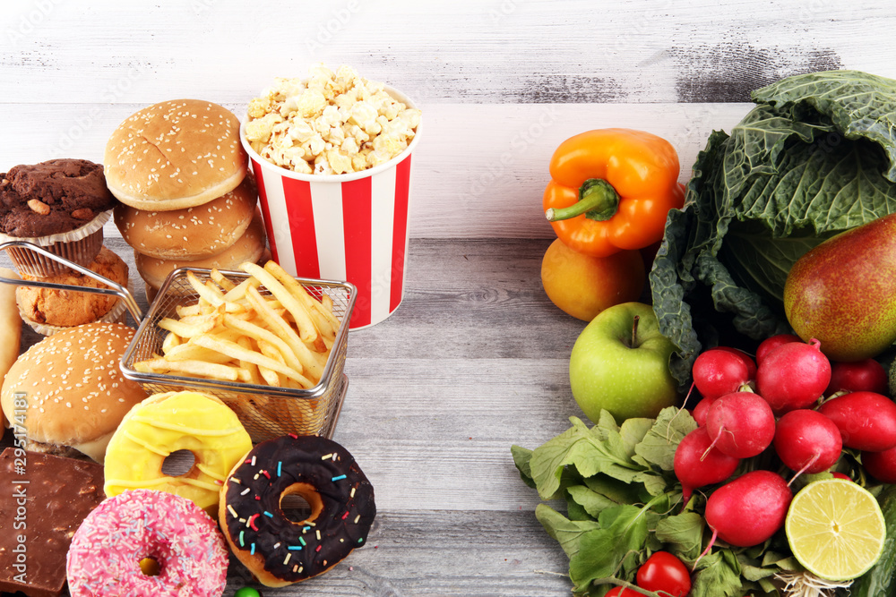 Fototapety, obrazy: healthy or unhealthy food. Concept photo of healthy and unhealthy food. Fruits and vegetables vs donuts and fast food