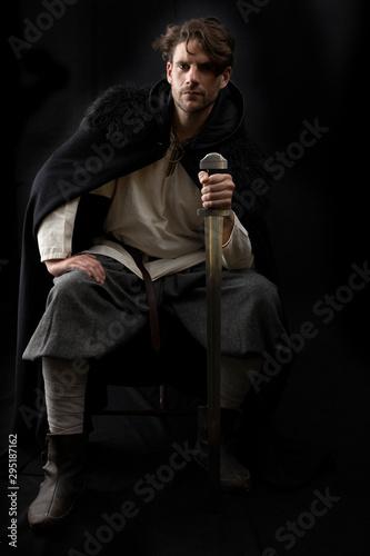 Photo  Dark-haired man in Viking costume