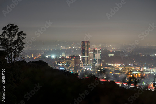 Fototapeta Foggy morning twilight view of the Burbank media district in the San Fernando Valley area of Los Angeles, California