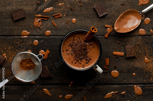 Recess Fitting Chocolate cup of hot chocolate on black wooden boards with drops of chocolate, cocoa