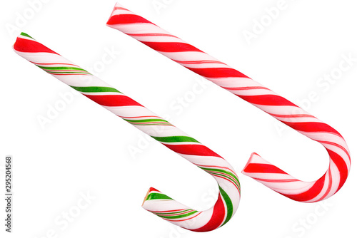 Duo of candy cane, traditional treat of Christmas. Cut out, isolated on a white background.