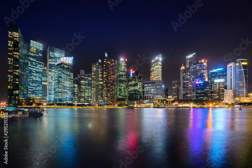 Singapore business district skyline financial downtown building with tourist sightseeing in night at Marina Bay, Singapore Canvas Print