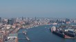 4K Aerial Elbe river and Hamburg city view at daytime, sailing ships and tall skyscrapers - Slow Motion