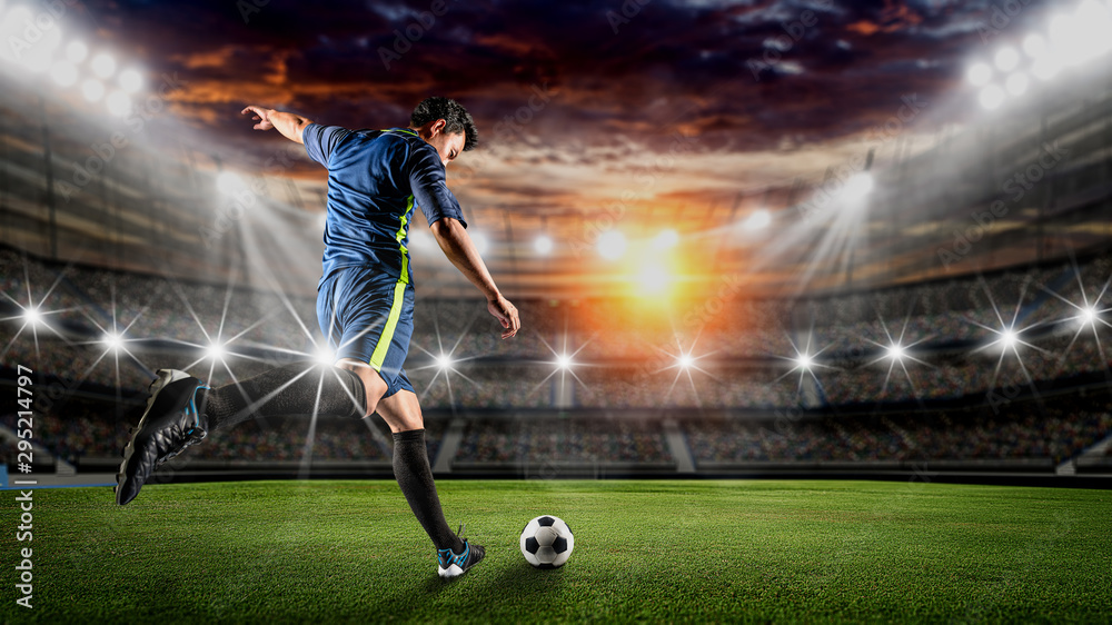 Fototapeta Soccer player kicks the ball on the soccer field.Professional soccer player in action.