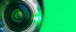 canvas print picture - Banner.  The camera lens and green backlighting. Green camera Lens close Up.