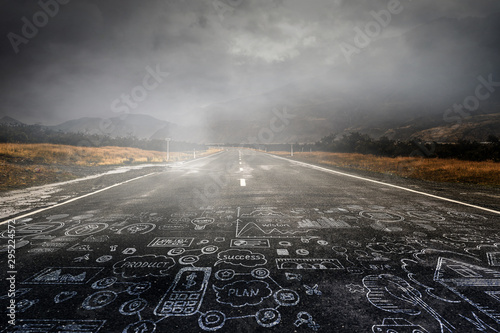 Poster Taupe Road in mountains landscape and dark sky