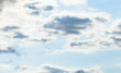 Beautiful puffy clouds isolated against blue skies