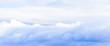 Leinwandbild Motiv Beautiful puffy clouds isolated against blue skies