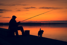 Fisher Man Fishing In Sunset.