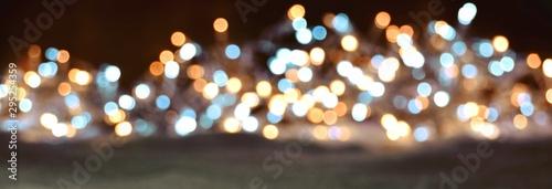 Fototapeta  Abstrakter  Panorama Hintergrund mit Bokeh Lichtern - Weihnachten und Silvester