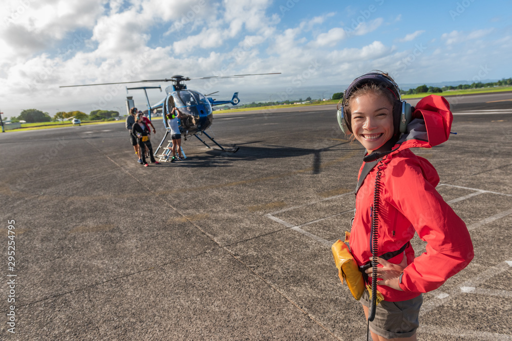 Fototapety, obrazy: Helicopter tour Asian tourist walking on airport tarmac going to tourism excursion summer travel vacation leisure activity. Woman looking at camera excited candid.