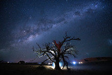 Deadvlei Is A White Clay Pan Located Near The More Famous Salt Pan Of Sossusvlei, Inside The Namib-Naukluft Park In Namibia With Milky Way At Night.