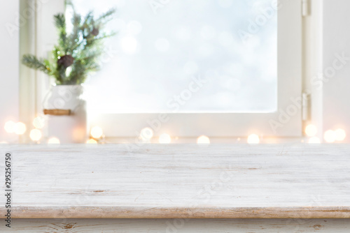 Blurred winter holiday background with vintage wooden table in front - 295256750