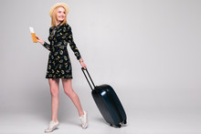 Full Length Of Young Woman In Casual Walking With The Travel Bag, Isolated On White Background