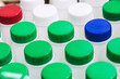 canvas print picture - plastic bottles with colorful beverage lids. Shallow depth of field