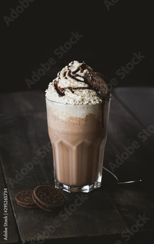 Fotografie, Obraz Chocolate cookie milkshake with whipped cream on wooden table