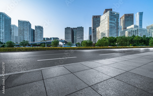 Montage in der Fensternische Grau Asphalt road and modern city commercial buildings in Beijing, China