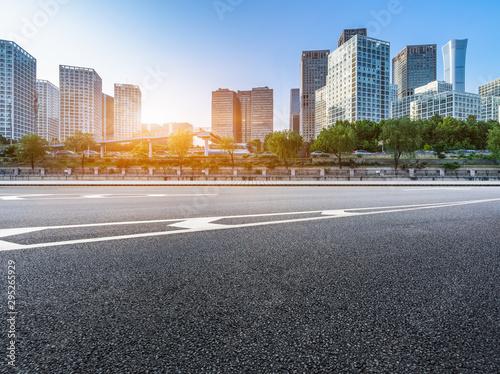 Fototapeta Asphalt road and modern city commercial buildings in Beijing, China obraz