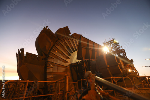Poster de jardin Taupe Mining reclaimer wheel bucket heavy machinery early morning sunrise at the back ground construction copper mine site New South Wall, Sydney, Austrian