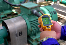 Workers Are Measuring The Temperature Of Motor With Infrared Thermometer