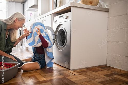 Deurstickers Wanddecoratie met eigen foto Grandma and granddaughter playing with clothes