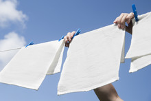 White Laundry Hanging On A Str...