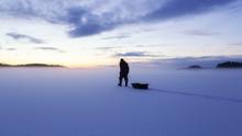 Man Silhouette Walk On The Ice...