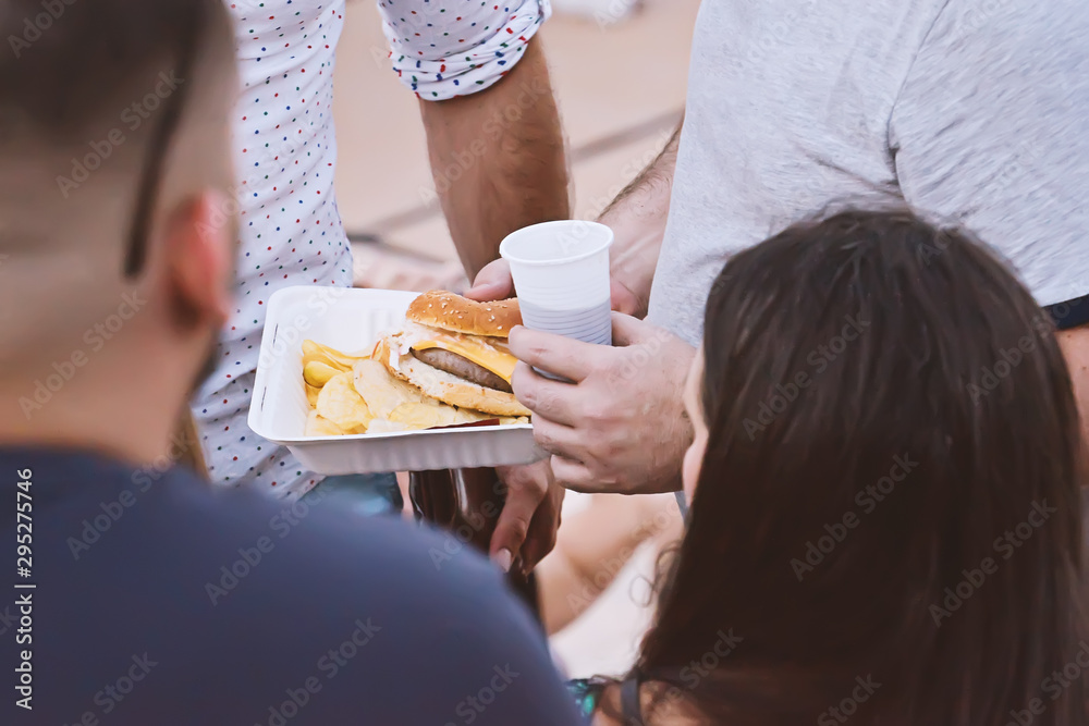 Fototapety, obrazy: Midsection of people eating fast food outdoor takeaway