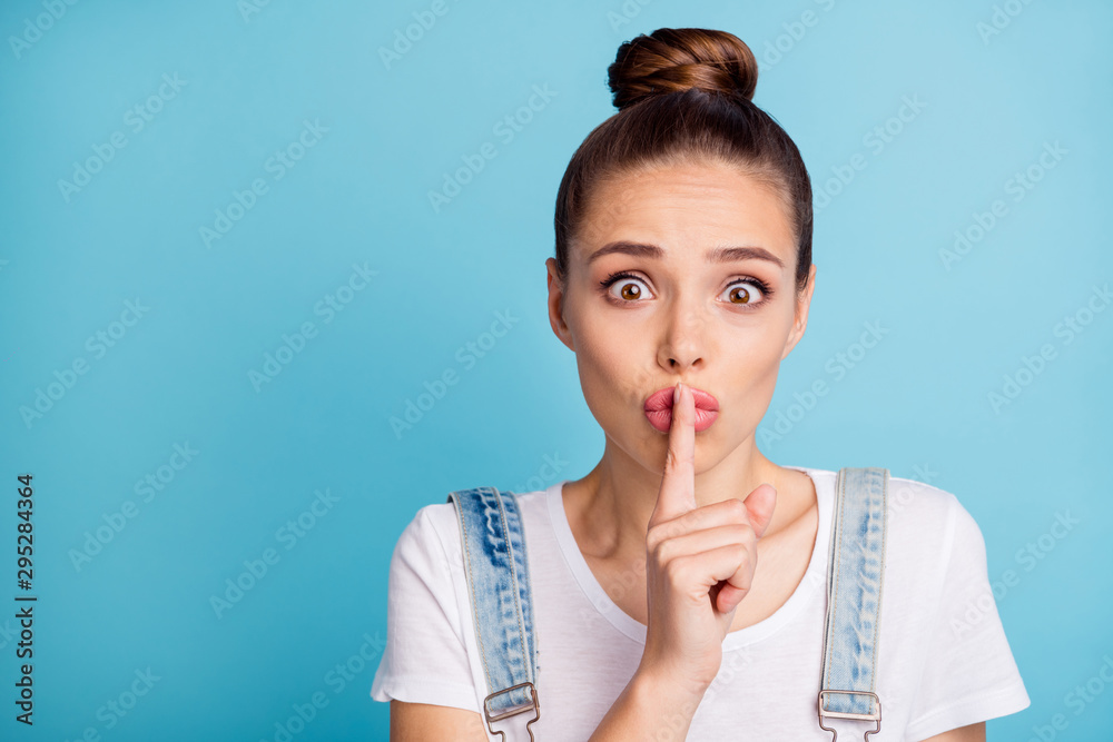 Fototapety, obrazy: Close up photo of frustrated girl with lips pouted plump wearing white t-shirt denim jeans overalls isolated over blue background