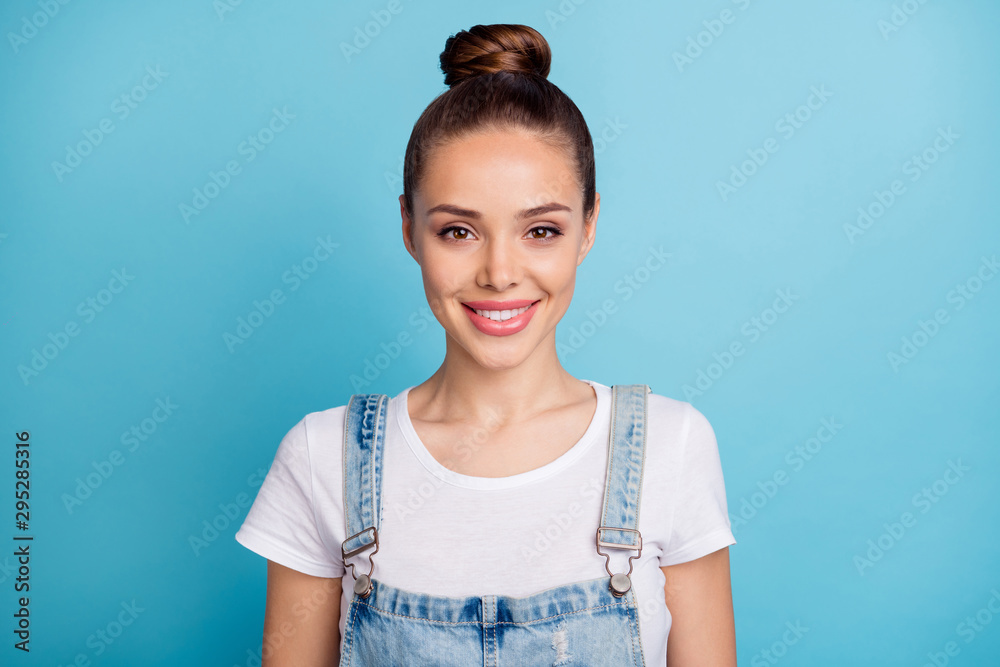 Fototapety, obrazy: Close up photo of charming lady looking with toothy smile wearing white t-shirt denim jeans overalls isolated over blue background